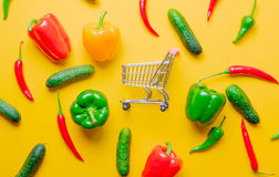 Chili pepper and cucumbers with shopping cart Royalty Free Stock Photo