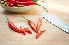 Chili pepper on cutting board. Red hot chili pepper on cutting board Stock Photo