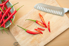 Chili pepper on cutting board. Red hot chili pepper on cutting board Stock Image