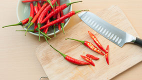 Chili pepper on cutting board. Red hot chili pepper on cutting board Royalty Free Stock Photo