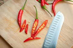 Chili pepper on cutting board. Red hot chili pepper on cutting board Royalty Free Stock Photos
