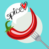 Chili pepper in fork with Royalty Free Stock Images