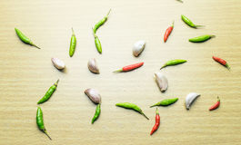 Chili pepper and garic. On wooden table Royalty Free Stock Photography