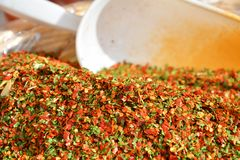 Chili pepper, garlic and parsley and market Royalty Free Stock Image