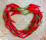 Chili pepper heart,on yellow bamboo basket stock image