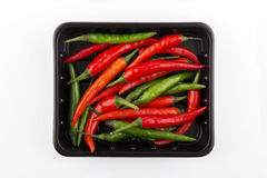 Chili pepper isolated. Black bowl with red hot chili pepper Royalty Free Stock Image