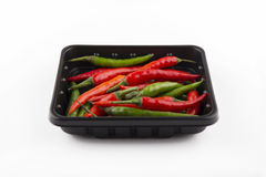 Chili pepper isolated. Black bowl with red hot chili pepper Royalty Free Stock Photos