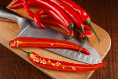 Chili pepper and knife Stock Image