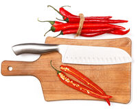 Chili pepper and knife Royalty Free Stock Photos