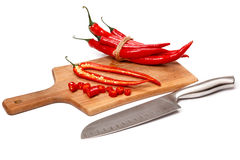 Chili pepper and knife Royalty Free Stock Image