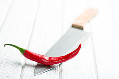 Chili pepper on knife Royalty Free Stock Images