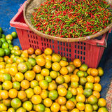 Chili pepper and lime for sale at asian market Stock Photos