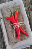 Chili pepper on linen texture and wooden table,spice Royalty Free Stock Images