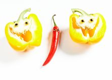 Chili pepper man and yellow bell pepper smile Royalty Free Stock Photography