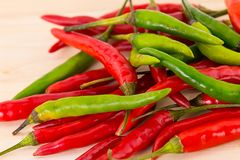 Chili pepper mix pods red green lot of fruit design seasoning acute sauce base of curry close-up stock photos
