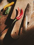 Chili pepper on old wooden cutting board Stock Photography