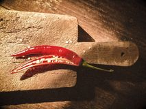 Chili pepper on old wooden cutting board Royalty Free Stock Image