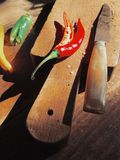 Chili pepper on old wooden cutting board Stock Photo