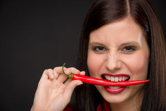 Chili pepper - portrait young woman red spicy Royalty Free Stock Photo