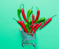 Chili pepper and shopping cart Stock Images