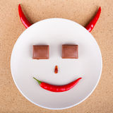 Chili pepper smiling face Royalty Free Stock Images