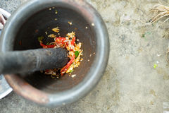 Chili pepper in wood mortar Stock Photography