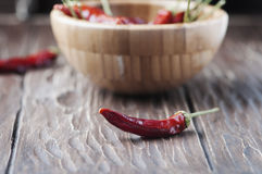 Chili pepper on the wooden table Royalty Free Stock Photography