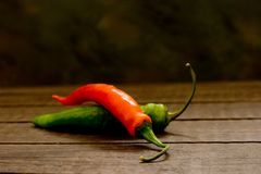 Chili Peppers. On a wooden surface Royalty Free Stock Images