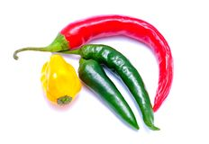 Chili peppers. Red, green and yellow chili peppers isolated on a white background Royalty Free Stock Photo
