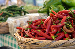 Chili peppers. Hot red chili peppers displayed among other peppers Stock Photo