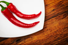 Chili peppers. Some chili peppers on a plate Royalty Free Stock Image