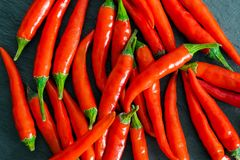 Chili Peppers Background on Black Rock Surface stock images