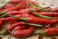 Chili peppers on basket Stock Photos
