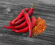 Chili peppers with chili flakes Stock Images