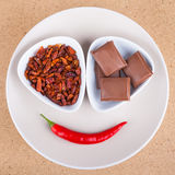 Chili peppers and chocolate Royalty Free Stock Images