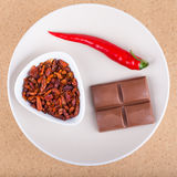 Chili peppers and chocolate Stock Photo