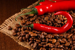 Chili peppers and coffee Stock Images