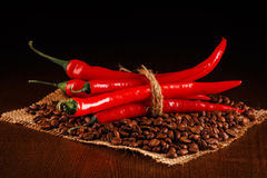 Chili peppers and coffee Royalty Free Stock Photography