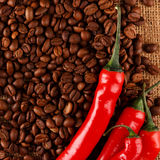 Chili peppers and coffee Stock Photography