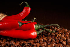 Chili peppers and coffee Royalty Free Stock Photo