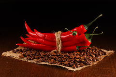 Chili peppers and coffee Stock Image