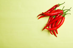 Chili peppers on colorful background Stock Photo