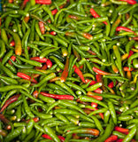 Chili peppers, on the counter market, background and textu Stock Photo