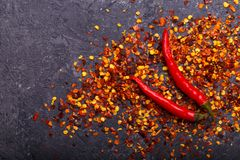 Chili Peppers And Flakes arkivbild