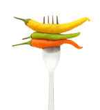 Chili peppers on fork Stock Photography