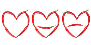Chili peppers forming shape of heart Stock Photos
