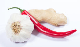 Chili peppers, garlic and ginger isolated on white background. Stock Images