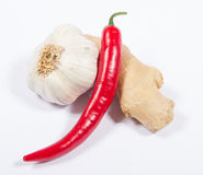 Chili peppers, garlic and ginger isolated on white background. Royalty Free Stock Photo