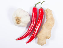 Chili peppers, garlic and ginger isolated on white background. Royalty Free Stock Image