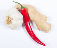 Chili peppers, garlic and ginger  on white background. Royalty Free Stock Photo